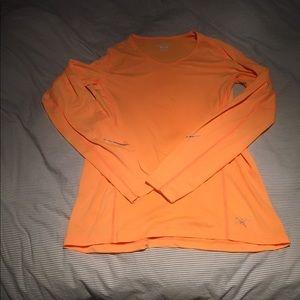 Arcteryx long sleeve orange running shirt. Size L